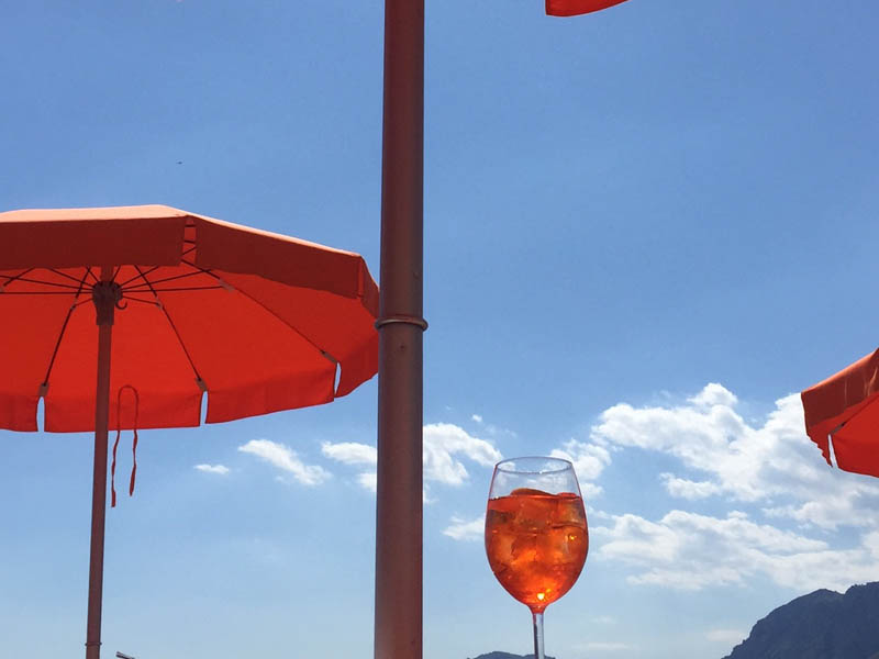 the colour of travel - orange aperol spritz in Italy